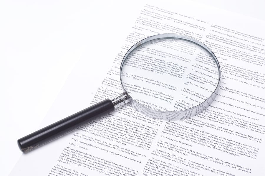 Magnifying Glass Lying On A Legal Contract
